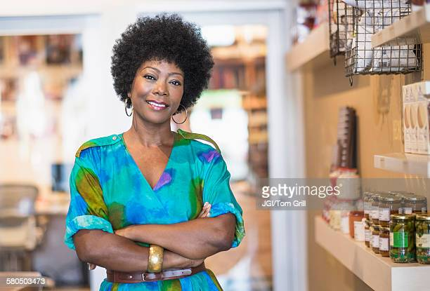African American business owner smiling in store