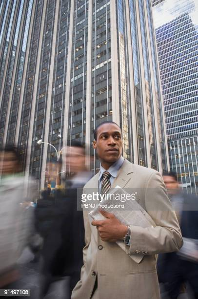 African American businessman holding newspaper