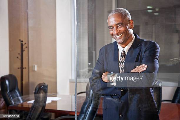 African American businessman in boardroom
