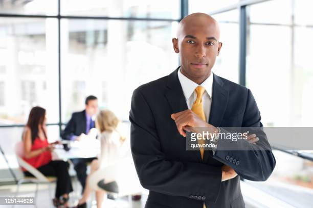 african american businessman in glass office with team, copy space - full suit stock pictures, royalty-free photos & images
