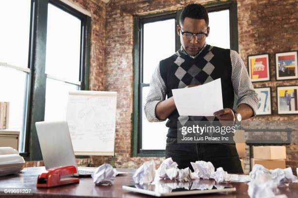 African American businessman reading in office
