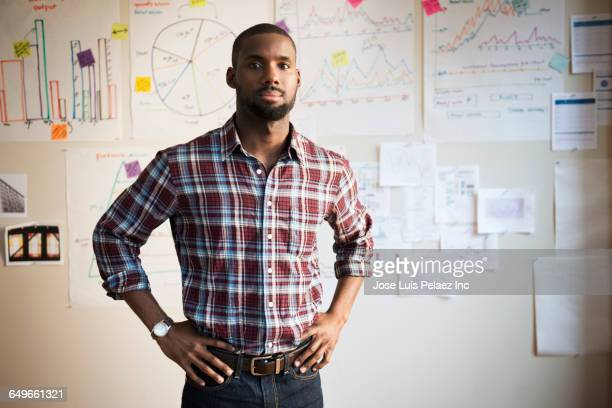 African American businessman standing in office