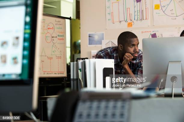 African American businessman using computer in office