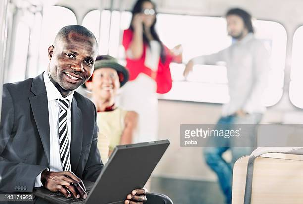 African American businessman using computor  on the bus