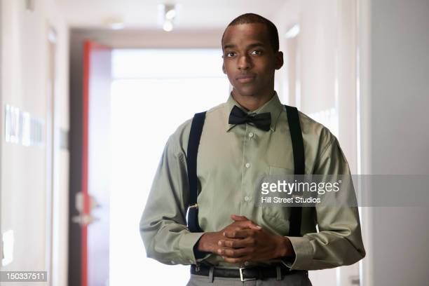 african american businessman with hands clasped - サスペンダー ストックフォトと画像