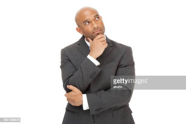 African American businessman with one hand on chin over