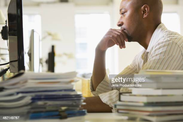 African American businessman working in office