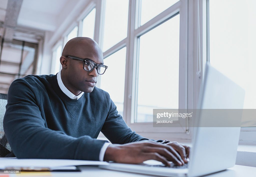 African american businessman working on his laptop : Stock Photo