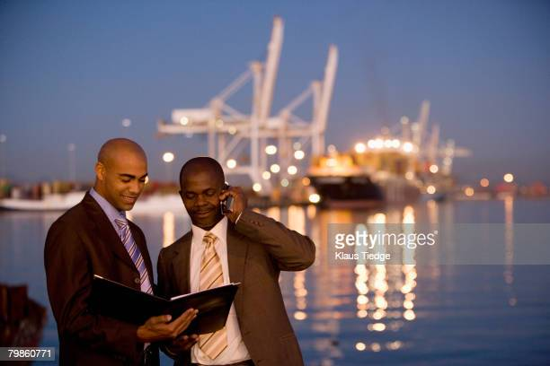 African American businessmen looking at paperwork