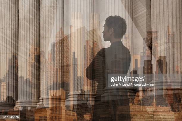 African American businesswoman admiring pillars