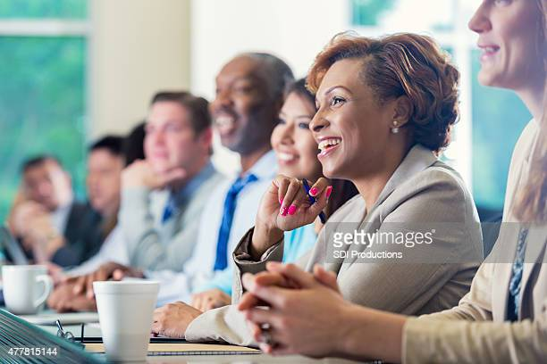 african american businesswoman attending seminar or job training business conference - attending photos stock photos and pictures