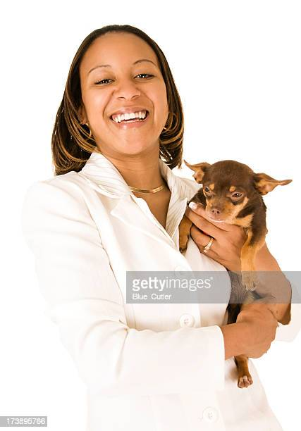 African American Businesswoman holding dog