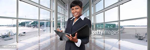 African American Businesswoman in Airport Terminal