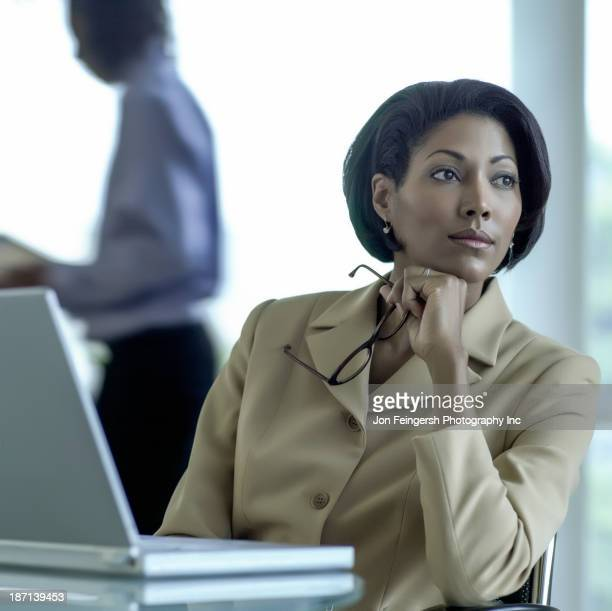 African American businesswoman sitting at desk