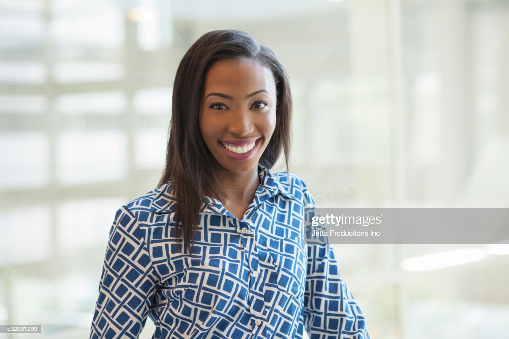 African American businesswoman smiling in office : Stock Photo