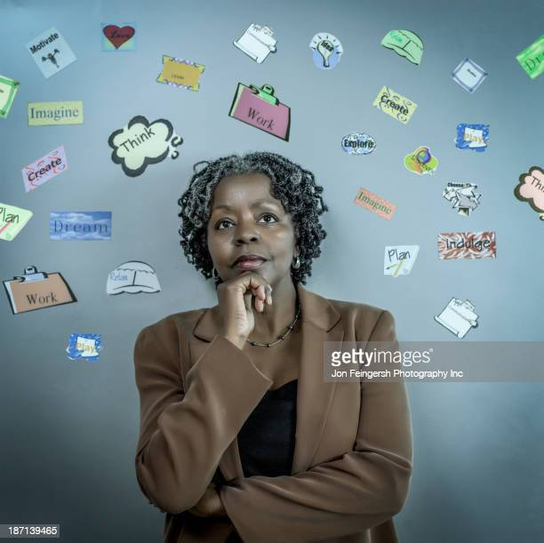 African American businesswoman surrounded by symbols