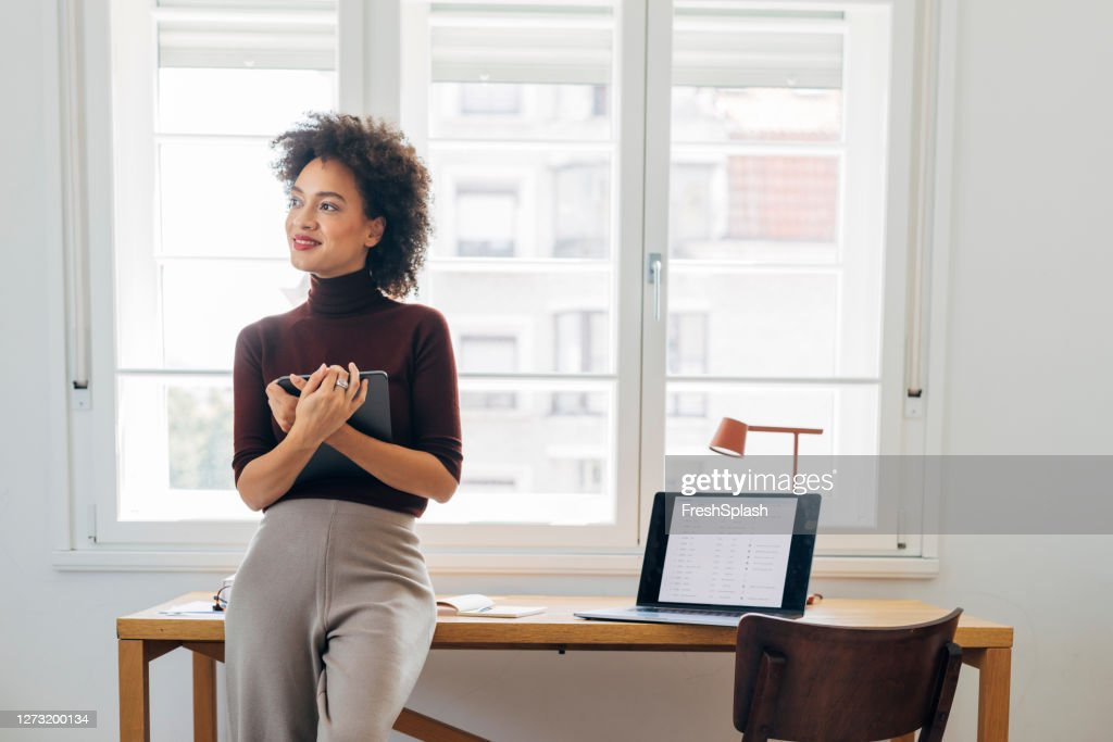 African American Businesswoman Using a Digital Tablet to Work from Home (Copy Space) : Stock Photo