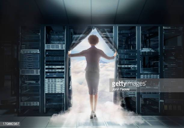 African American businesswoman walking into clouds