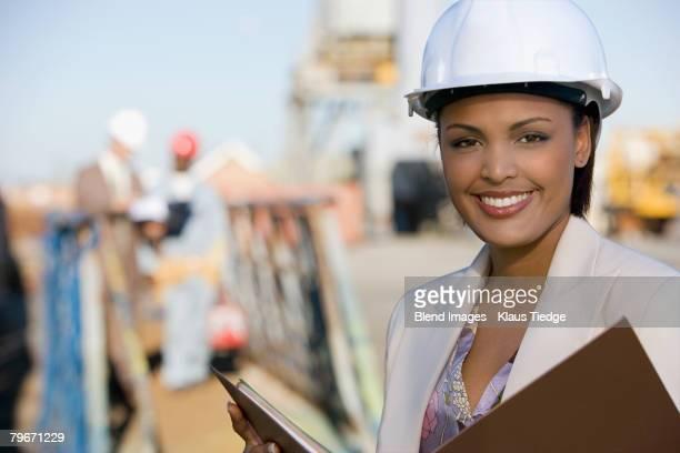 African American businesswoman wearing hardhat