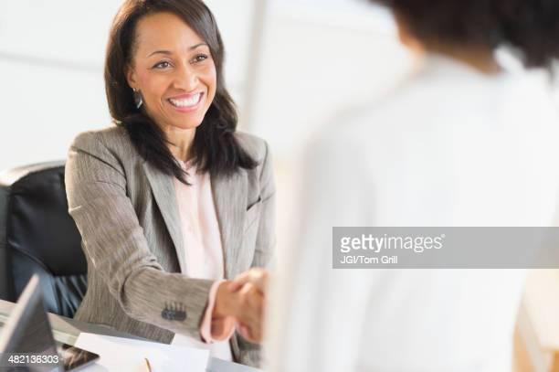 African American businesswomen shaking hands