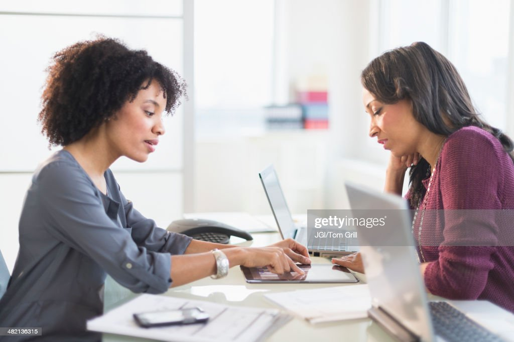 African American businesswomen talking in meeting : Stock Photo