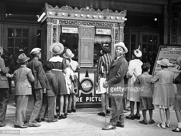 African American Chicagoans dressed in their Sunday best wait in line for the movies on Easter Sunday in 1941