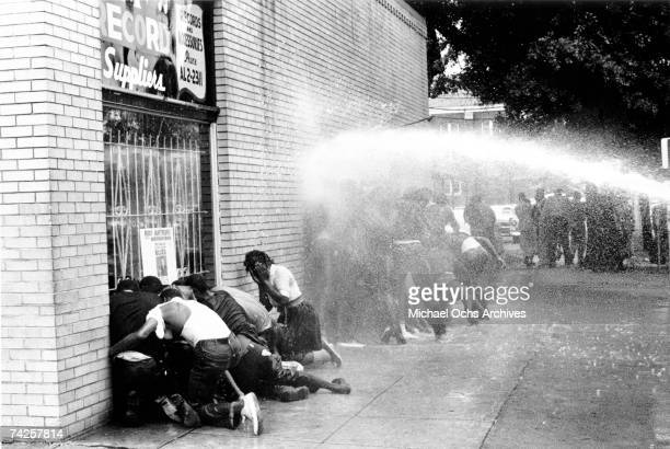 African American children are attacked by dogs and water cannons during a protest against segregation organized by Reverend Dr. Martin Luther King...