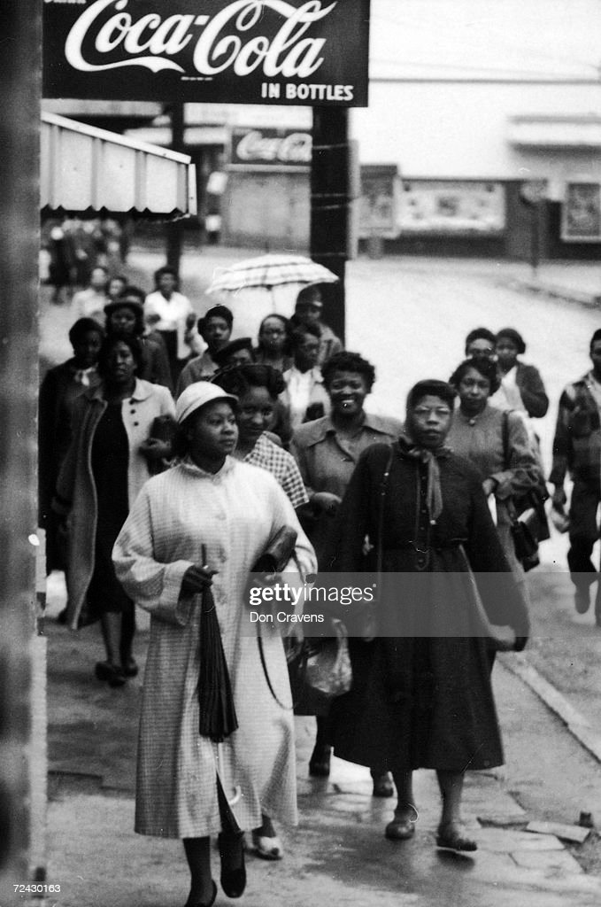 African American citizens walking to work and/or shopping : News Photo