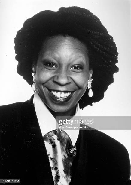 African American comedian and actress Whoopi Goldberg smiles for the camera, 1980.