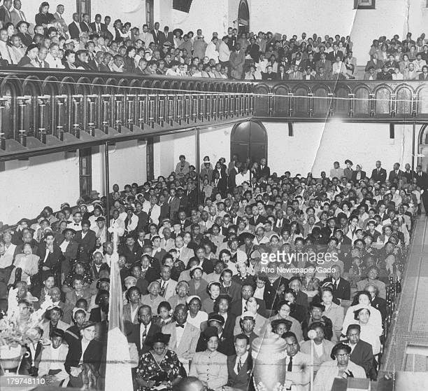 African American community gathers for the Emmett Till protest at Sharp St Church 1955