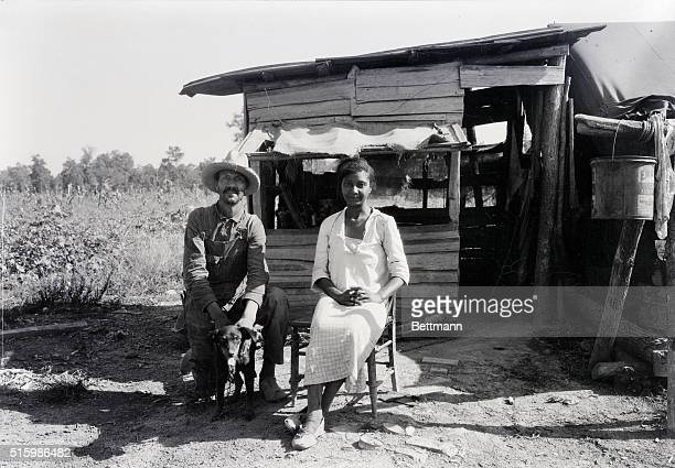 African American cotton pickers sitting in front of their shack C1930's PH Lundberg