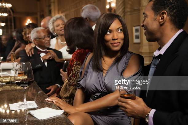 African American couple drinking at bar