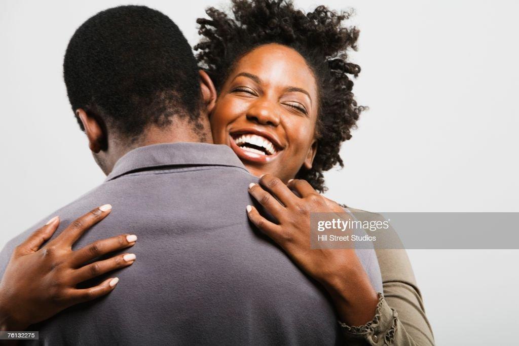 African American couple hugging : Stock Photo