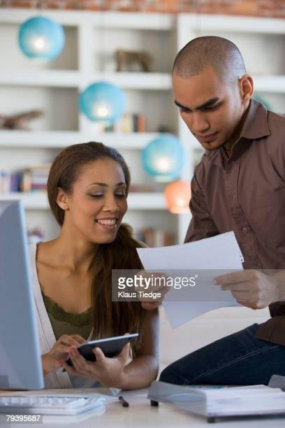 African American couple paying bills online