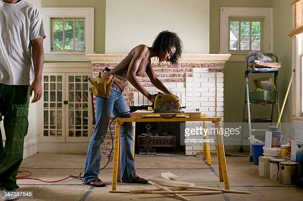 african american couple renovating home interior. - circular saw stock photos and pictures