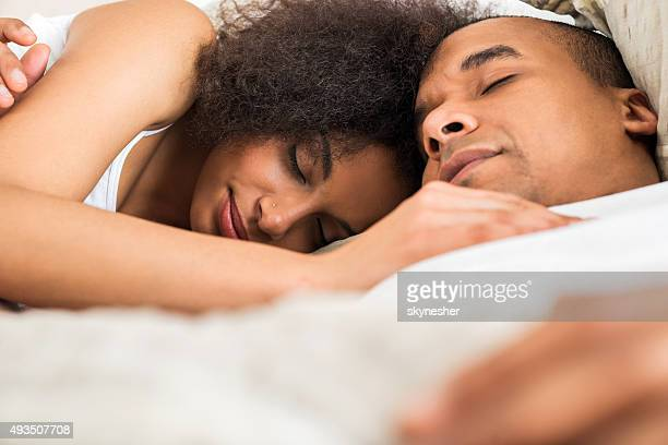 african american couple sleeping in bed. - black man sleeping in bed stock pictures, royalty-free photos & images