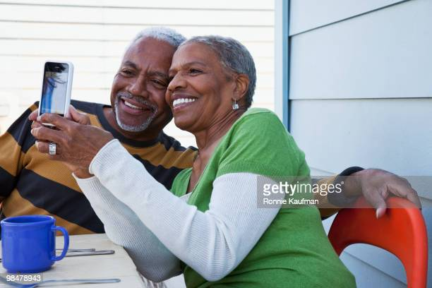 African American couple taking self-portrait