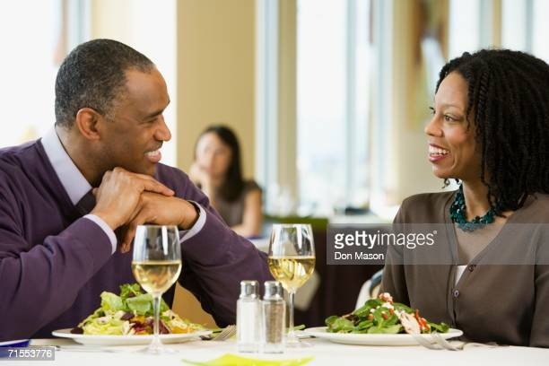 African American couple talking at restaurant