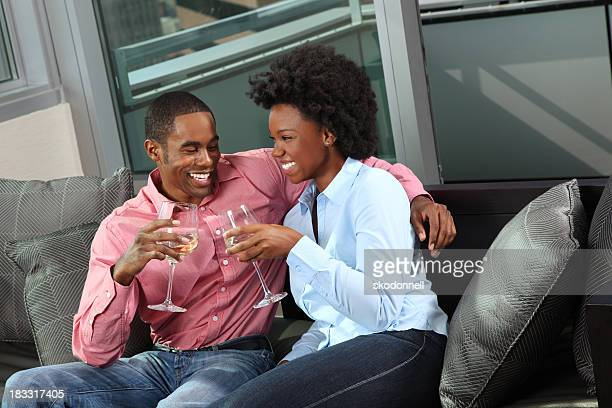 African American Couple Toasting on the Couch
