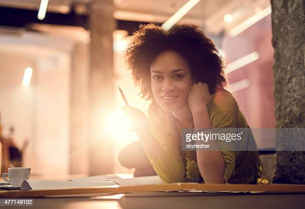 African American creative woman smiling and looking at camera.
