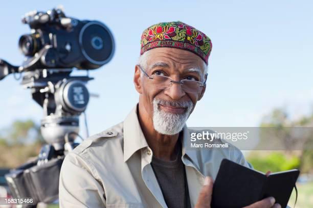 african american director near film camera - film director stock-fotos und bilder