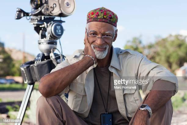 African American director near film camera
