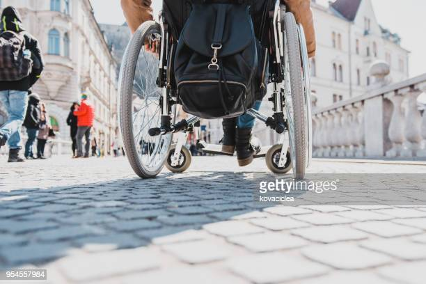 African American disabled woman in a wheelchair in the city centre