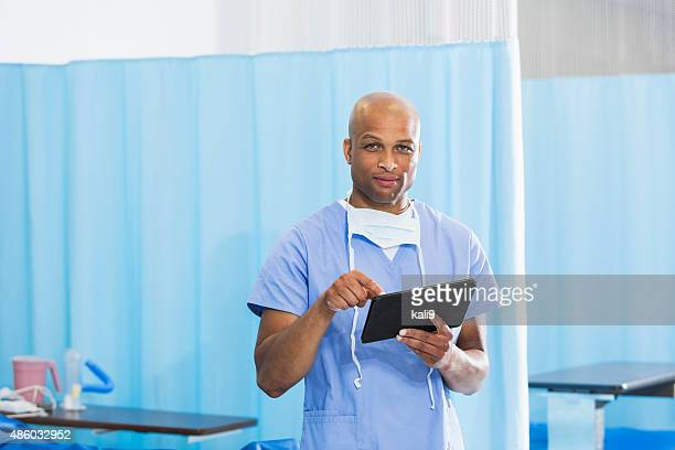 African American doctor in hospital with digital tablet
