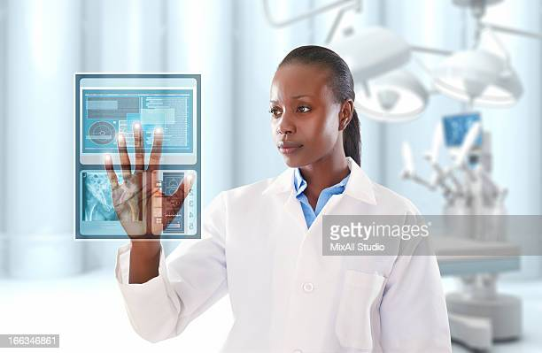 African American doctor looking at digital display in doctor's office