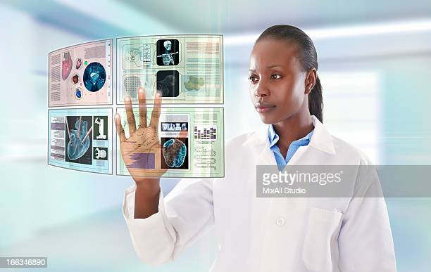 African American doctor using digital display
