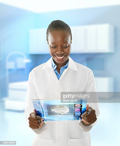 African American doctor using digital tablet in doctor's office