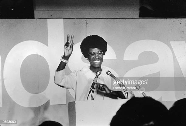 African American educator and US congresswoman Shirley Chisholm stands at a podium and gives the victory sign circa 1968