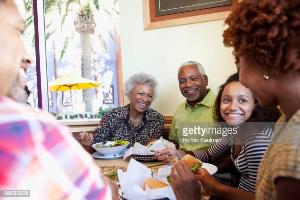 african american family eating in restaurant - african american family dinner - fotografias e filmes do acervo