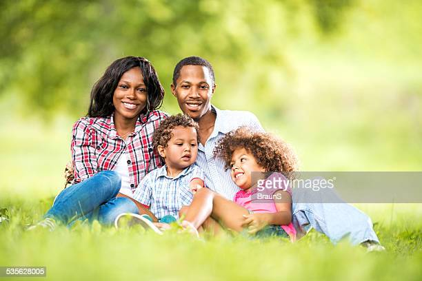 African American family in grass.